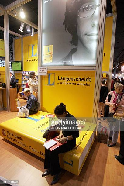 German dictionary publisher Langenscheidt's stand at the Frankfurt Book Fair 08 October 2004 AFP PHOTO JOHN MACDOUGALL