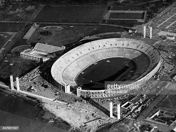 Germany, german Empire, Berlin, the Olympic stadium under construction, aerial view- Photographer: Hans Schaller- published by B.Z. Vintage property...