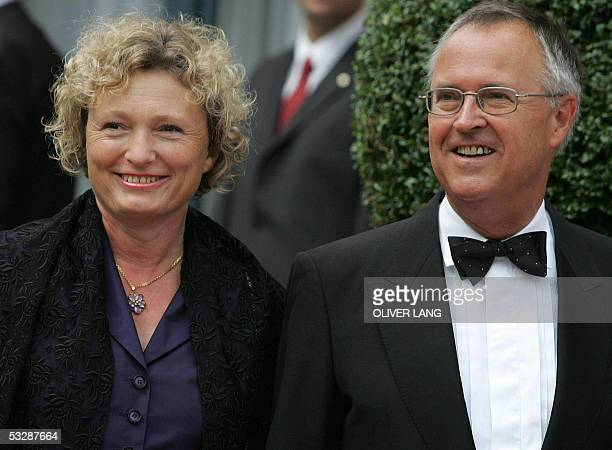 German Finance minister Hans Eichel arrives for the opening of Bayreuth's Wagner festival with his partner Gabriela Wolff 25 July 2005. Eichel, 63...
