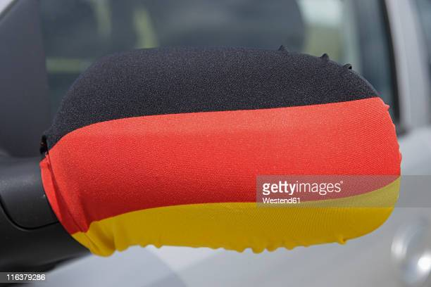 Germany, German flag on wing mirror of car