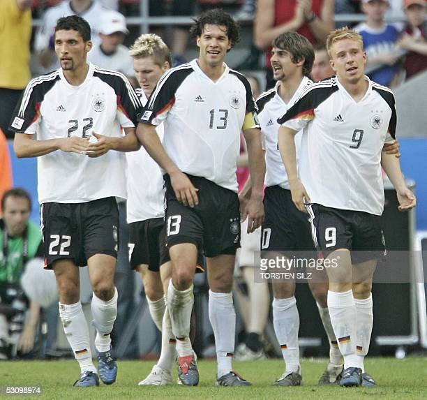 German midfielder Michael Ballack German forward Kevin Kuranyi and German forward Mike Hanke celebrate at the end of the Confederations cup football...