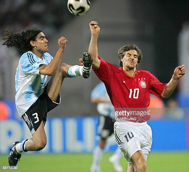 German midfielder Sebastian Deisler vies with Argentinian defender Juan Sorin during the 2005 FIFA Confederations Cup football match Argentina vs...