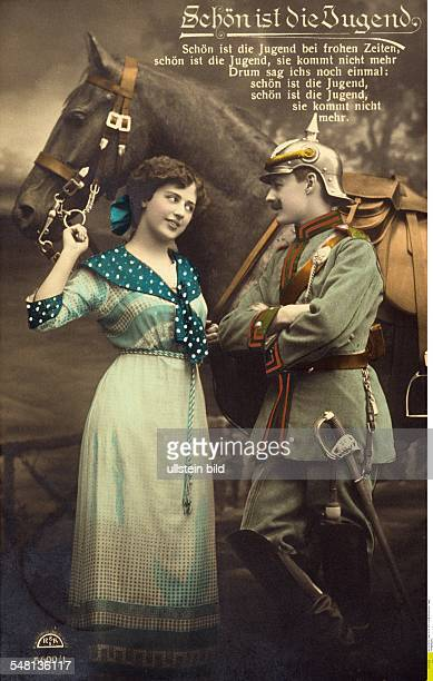 German postcards sent from the front during World War I Postcard depiciting a soldier and his sweetheart caption 'Youth is beautiful' 19141918