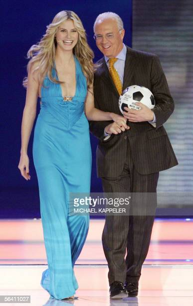 German top model Heidi Klum arrives on stage with German football legend and President of the German 2006 FIFA World Cup Organising Committee Franz...