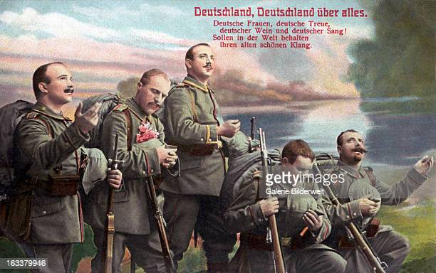 'Germany Germany above all' 1915 A group of German soldiers with guns in reverent attitude First World War Colored postcard