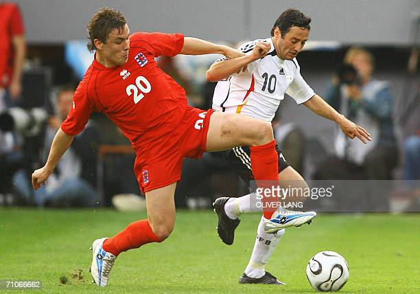 Germany's striker Oliver Neuville vies against Luxemburg's Tom Schnell, 27 May 2006 at the Badenova-Stadion in Freiburg, southern Germany, during...