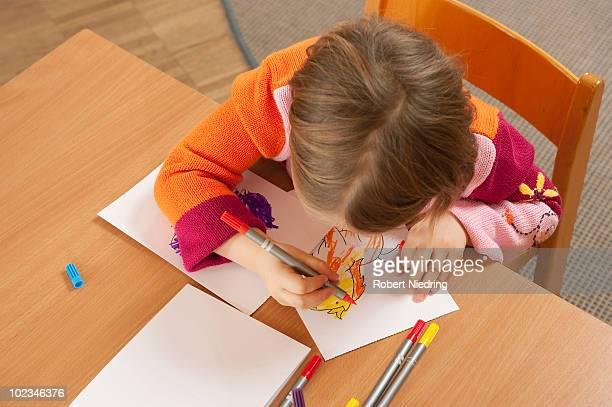 germany, girl (3-4) in nursery drawing a picture, elevated view - colouring book stock photos and pictures
