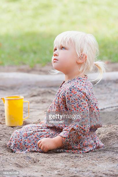 Germany, Girl sitting on playground