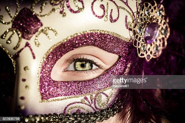 Germany, Girl wearing Venecian carnival mask