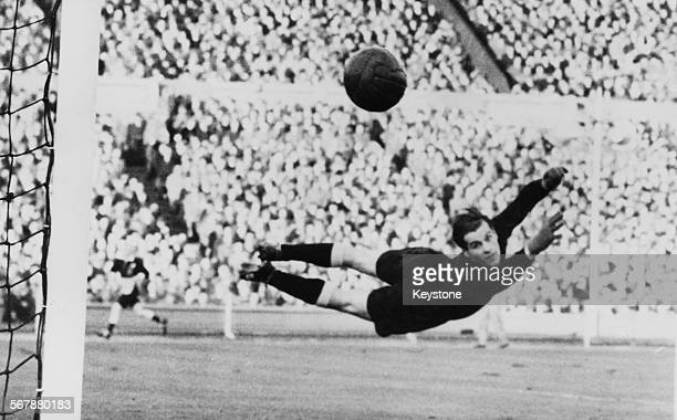 Germany goalkeeper Fritz Herkenrath reaches for a shot from England's Roy Bentley during a friendly match at Wembley Stadium London 1st December 1954...