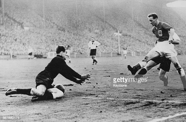 Germany goalkeeper Fritz Herkenrath reaches for the ball as Tom Finney of England rushes in during a friendly match at Wembley Stadium London 1st...