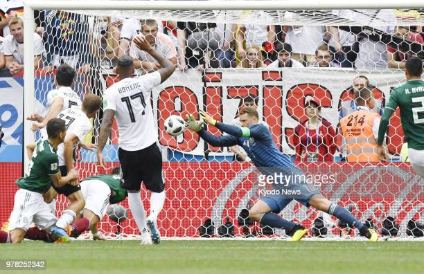 Germany goalkeeper Manuel Neuer makes a save during the first half of a 10 loss to Mexico in a World Cup Group F match in Moscow on June 17 2018...