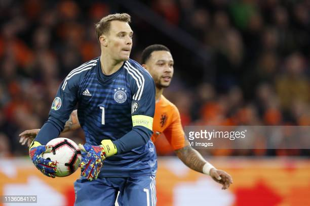 Germany goalkeeper Manuel Neuer Memphis Depay of Holland during the UEFA EURO 2020 qualifier group C qualifying match between The Netherlands and...