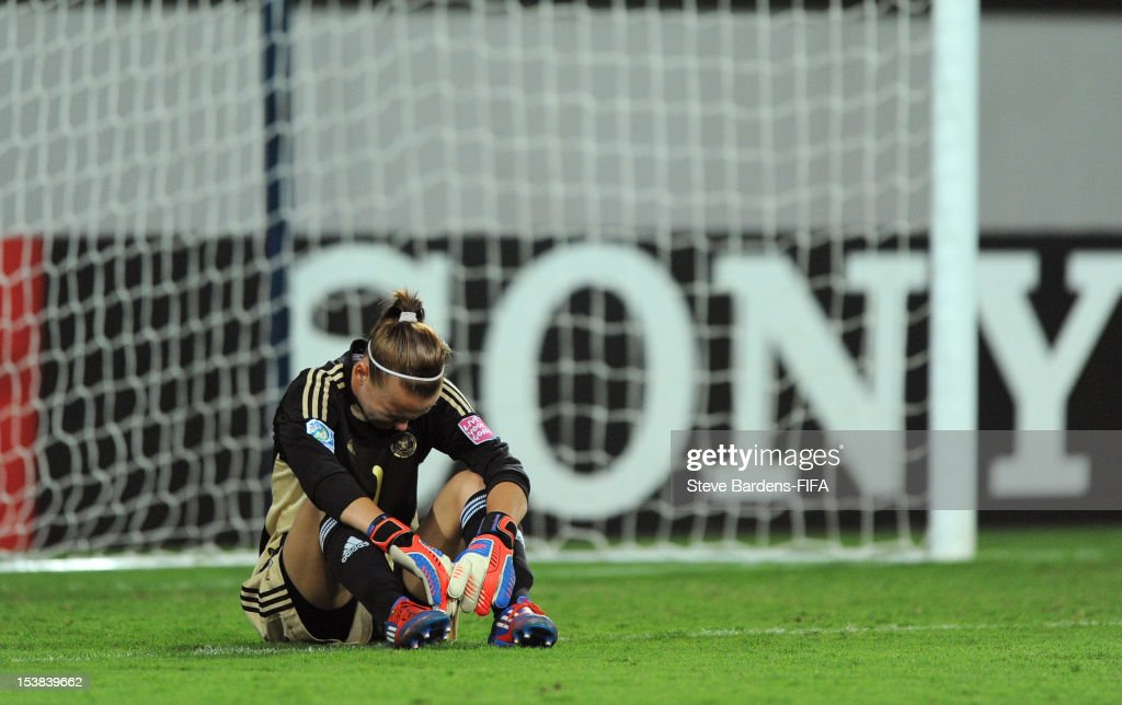 Germany Goalkeeper Merle Frohms sits dejected at the final whistle of the FIFA U-17 Women's World Cup 2012 Semi-Final match between Korea DPR and Germany at 8KM Stadium on October 9, 2012 in Baku, Azerbaijan.