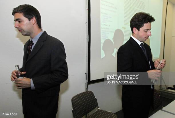 Google cofounders Larry Page and Sergey Brin part after addressing a press conference at the Frankfurt Book Fair 07 October 2004 AFP PHOTO JOHN...