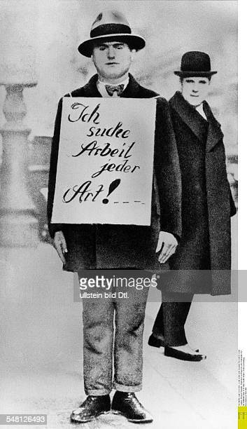 Germany great depression 192932 An unemployed in a street in Berlin wearing a poster Im seeking work of any kind 1932
