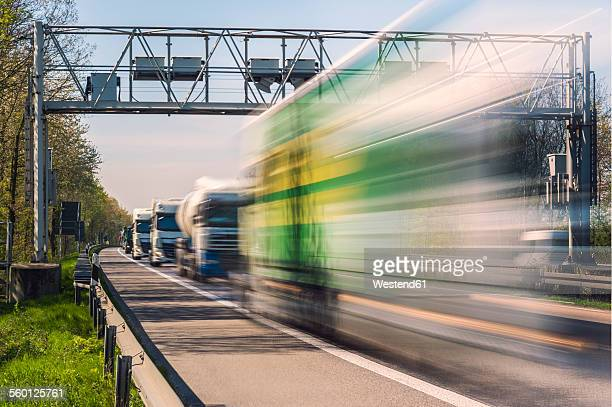Germany, Grevenbroich, Lorries and toll bridge