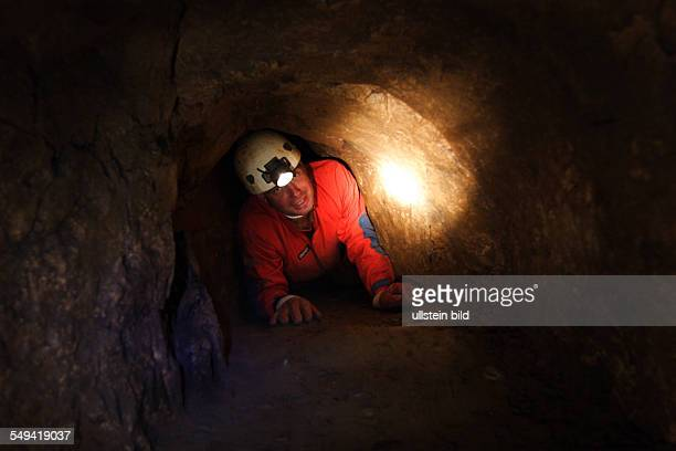 Germany, Hagen: This cave is called BLAETTERHOEHLE and you can see two archeologists looking for prehistorical human findings.