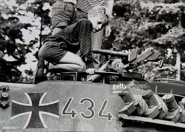 Germany Hamburg boy on military tank of the German Army