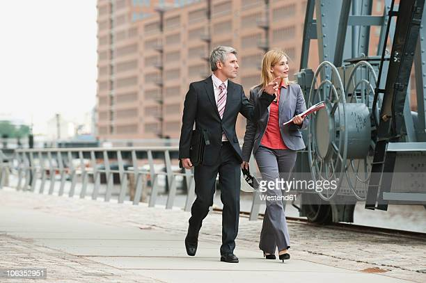 Germany, Hamburg, Business people at harbour
