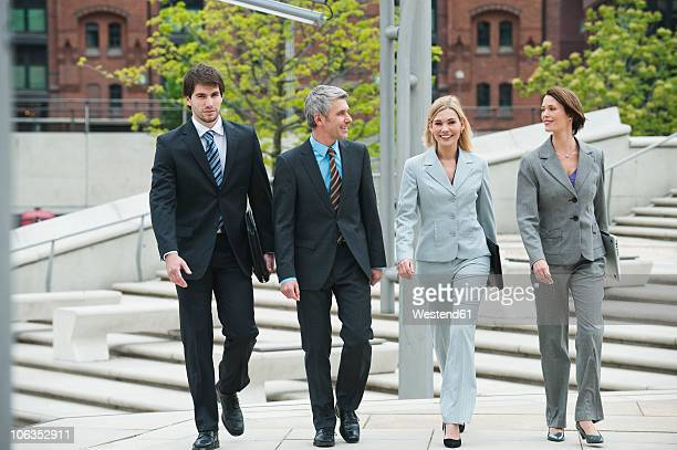 Germany, Hamburg, Business people walking together