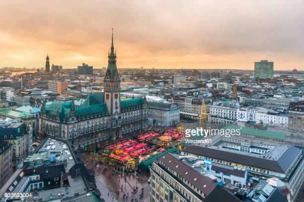 Germany, Hamburg, Christmas market at town hall in the evening