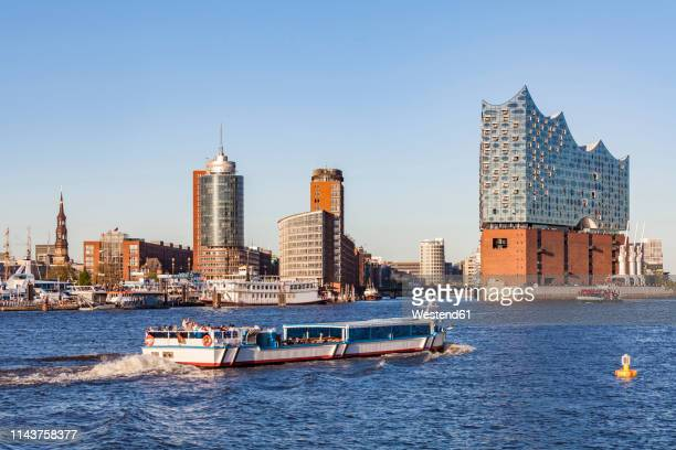 Germany, Hamburg, cityscape with Elbe Philharmonic Hall and tourboat on the Elbe
