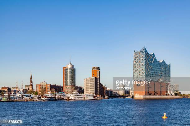 germany, hamburg, cityscape with elbe philharmonic hall seen from the water - elbphilharmonie stock pictures, royalty-free photos & images