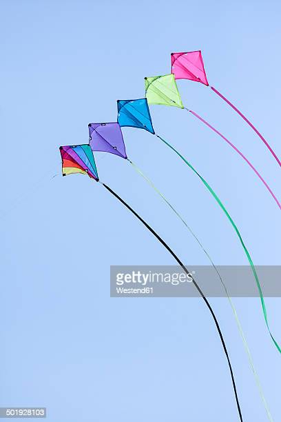 Germany, Hamburg, colourful kites, blue sky