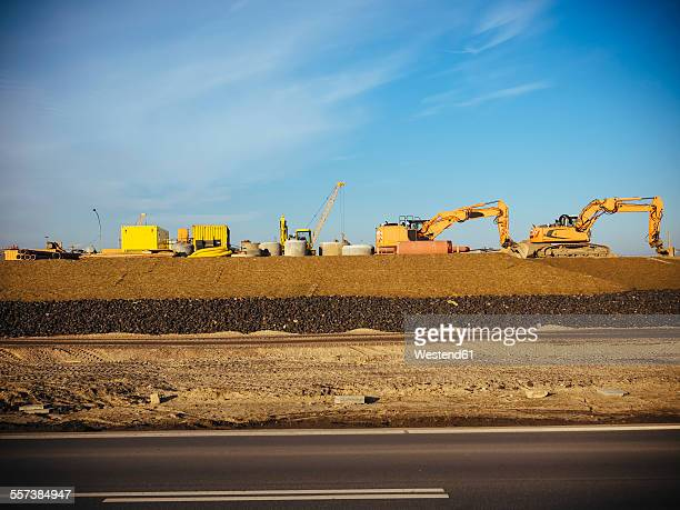 Germany, Hamburg, construction machines at roadworks