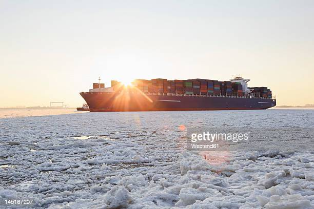 germany, hamburg, container ship on ice covered river elbe - pack ice stock pictures, royalty-free photos & images
