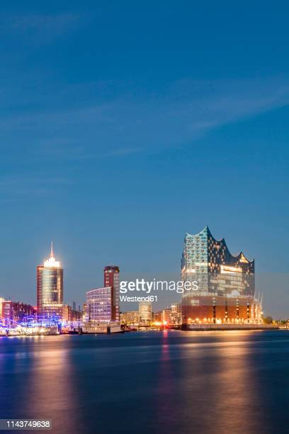 germany, hamburg, elbe philharmonic hall and hafencity at blue hour - elbphilharmonie stock pictures, royalty-free photos & images