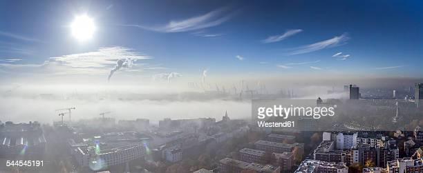 Germany, Hamburg, Elbe River and city in dense fog