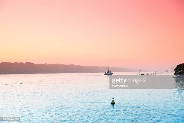 germany, hamburg, finkenwerder, elbe river in morning light - elbe river stock photos and pictures
