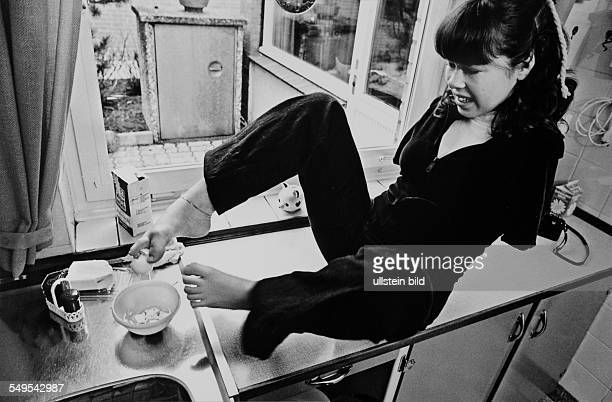 Germany Hamburg handicaped teenager affected by Contergan preparing food with her feet