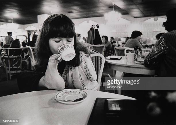 Germany Hamburg handicaped teenager bei Contergan holding the coffee pot with her foot