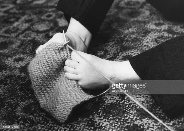 Germany Hamburg handicaped woman by Contergan knitting with her feet