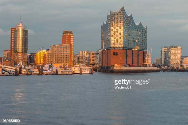 germany, hamburg, harbour and elbe philharmonic hall in the evening light - elbphilharmonie stock pictures, royalty-free photos & images