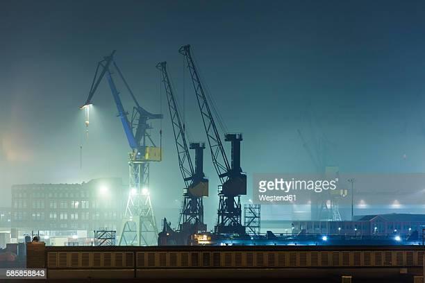Germany, Hamburg, harbour cranes at Port of Hamburg by night