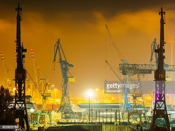Germany, Hamburg, harbour cranes at Port of Hamburg by night