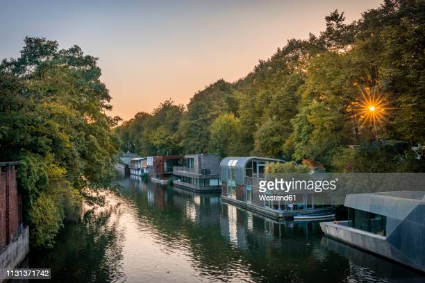 germany, hamburg, hoseboats on elbe canal - houseboat stock pictures, royalty-free photos & images