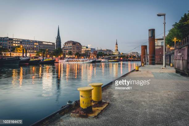 germany, hamburg, inland harbour and cityscape at blue hour - porto marittimo foto e immagini stock