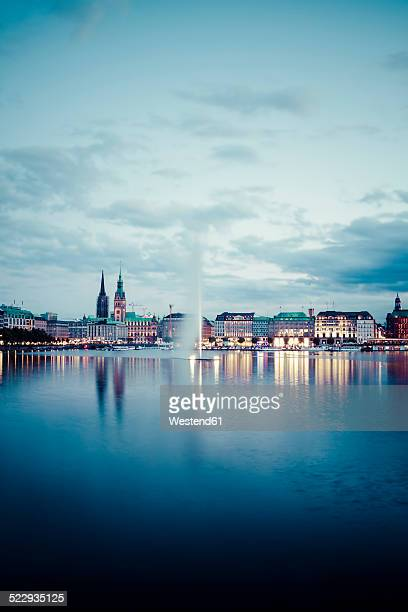 Germany, Hamburg, Inner Alster and Alster fountain in the evening