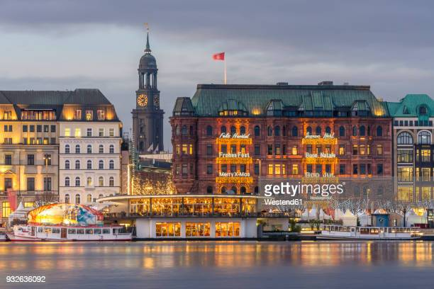 germany, hamburg, jungfernstieg and st. michaelis church at christmas time - hamburg germany stock pictures, royalty-free photos & images