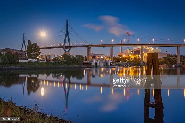 germany, hamburg, koehlbrand bridge and full moon at night - köhlbrandbrücke stock photos and pictures
