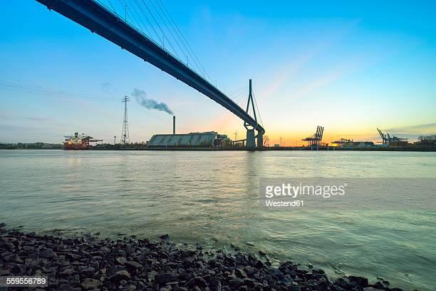 germany, hamburg, koehlbrandbruecke and harbor at sunset - köhlbrandbrücke stock photos and pictures