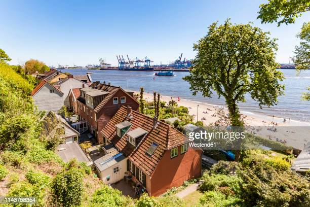 germany, hamburg, oevelgoenne, captain's houses and pilot houses at the elbe shore seen from himmelsleiter - エルベ川 ストックフォトと画像
