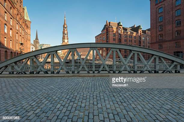 Germany, Hamburg, old warehouse district, Speicherstadt with St Catherine's church at sunrise