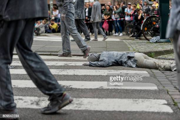 Germany Hamburg on 7 July 2017 In the art performance the protagonists wear encrusted clothes and stand for a society that has emerged from its...