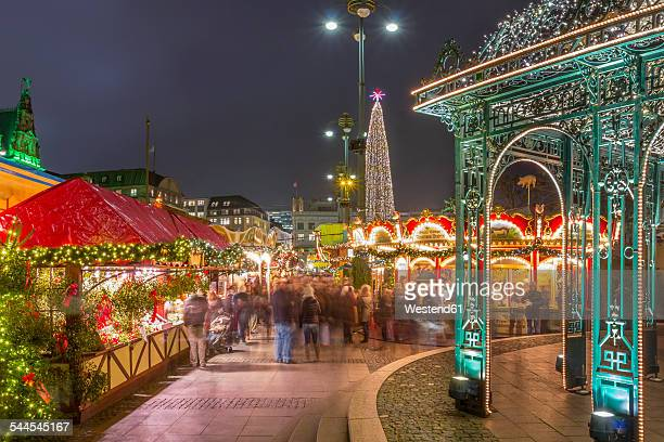 Germany, Hamburg, People at Christmas market in front of town hall